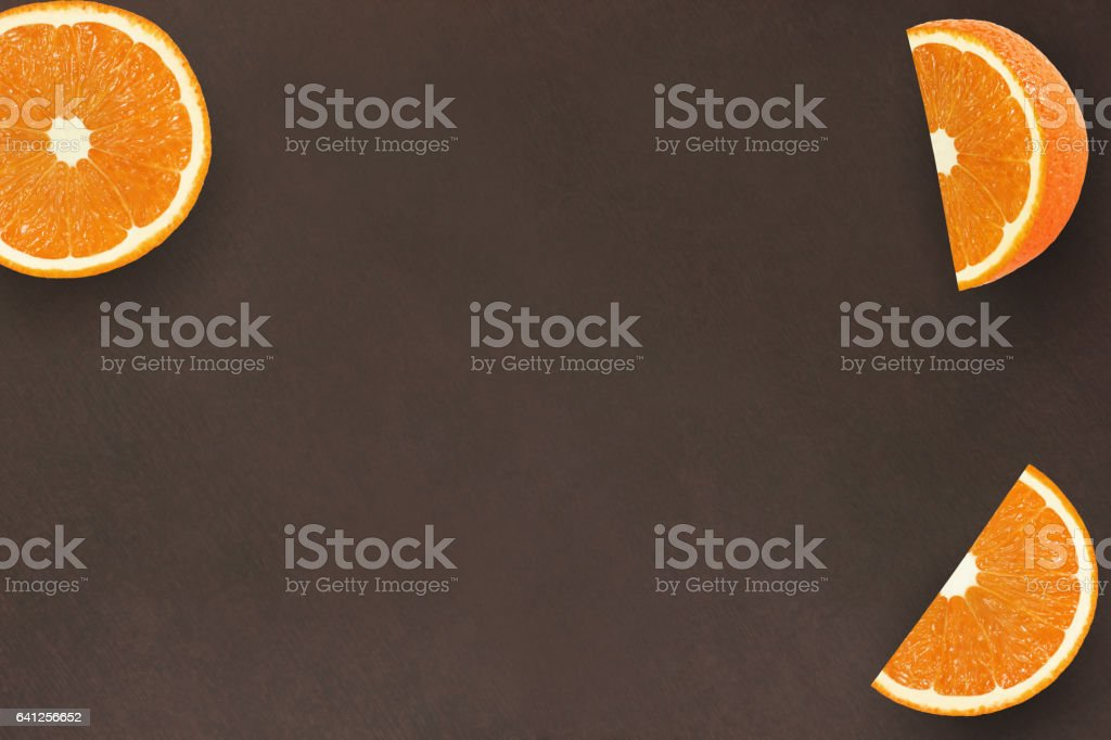 orange fruits on dark wood background color wenge abstract texture background stock photo