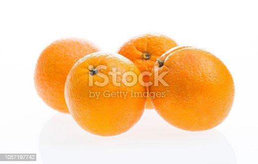 Orange fruits on white background.