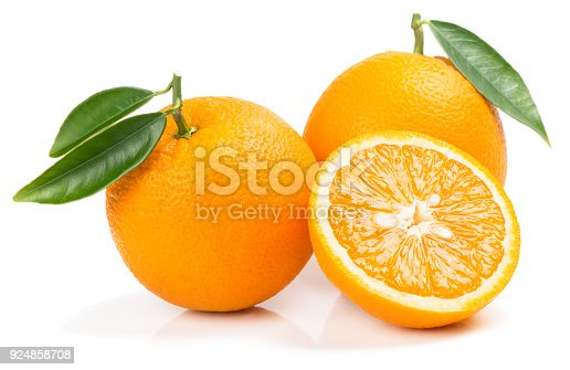 Two whole orange fruits and half with green leaves isolated on white background.
