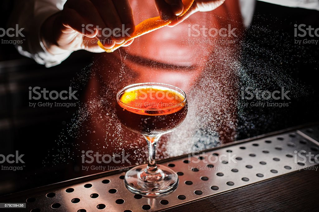 Orange garnish spray over a drink stock photo