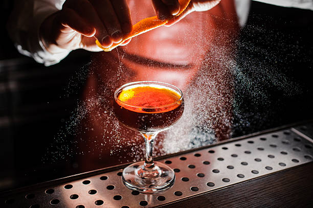 Orange garnish spray over a drink - foto de acervo