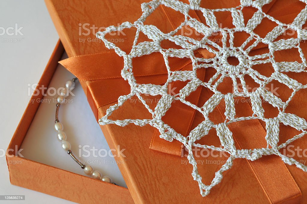 Orange Gift Box with Star and Pearls royalty-free stock photo