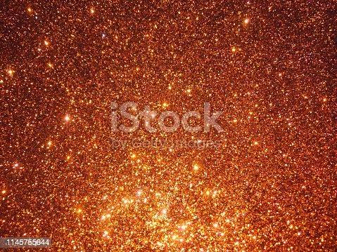 857847778 istock photo Orange glitter 1145755644