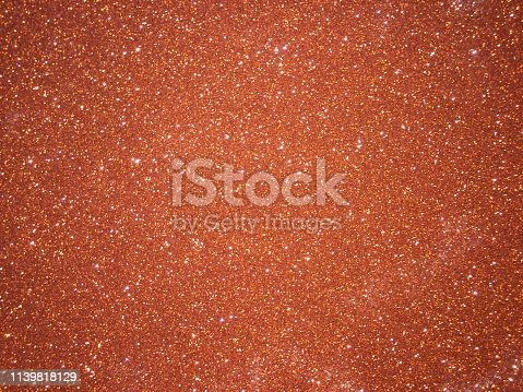 617566268 istock photo Orange glitter texture 1139818129