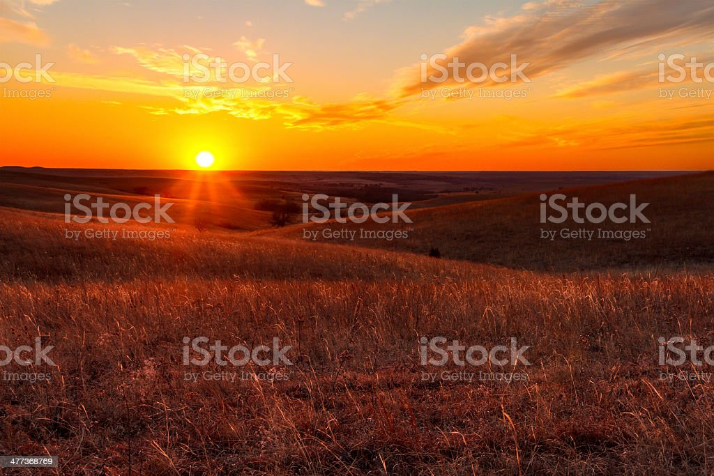 Orange glow of a sunset in Kansas Flint Hills stock photo