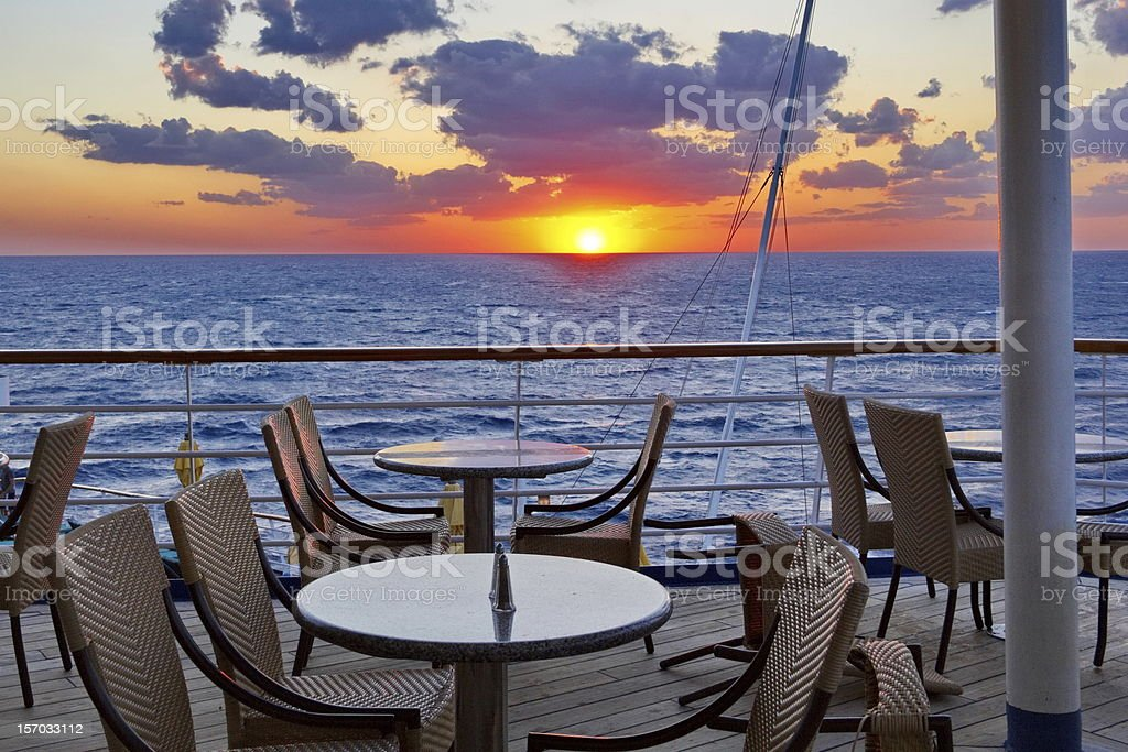 Orange Glow Sunset from the Cruise Ship Dining Deck royalty-free stock photo