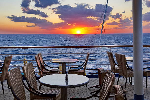 Orange Glow Sunset from the Cruise Ship Dining Deck stock photo