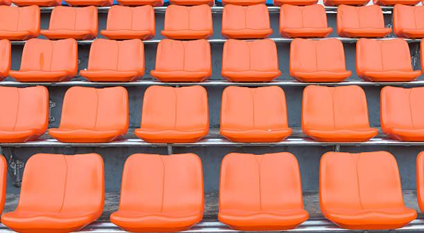 orange grandstand chairs stock photo