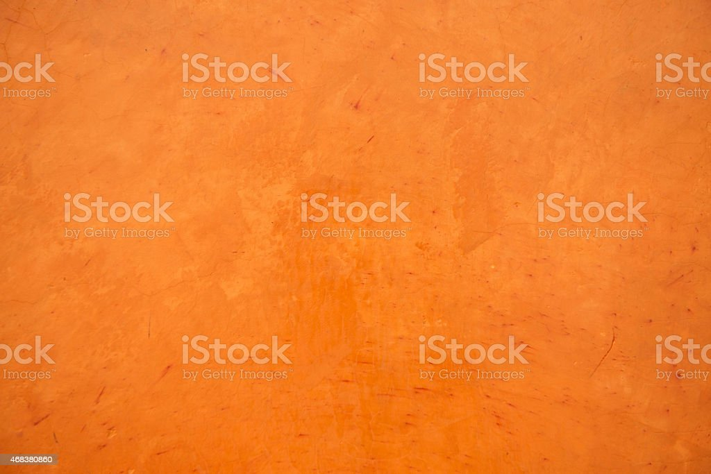 Orange grunge concrete wall textured and background. stock photo