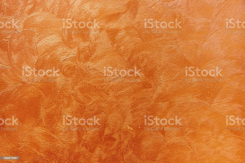 orange grungy cement texture on the wall in abstact stock photo