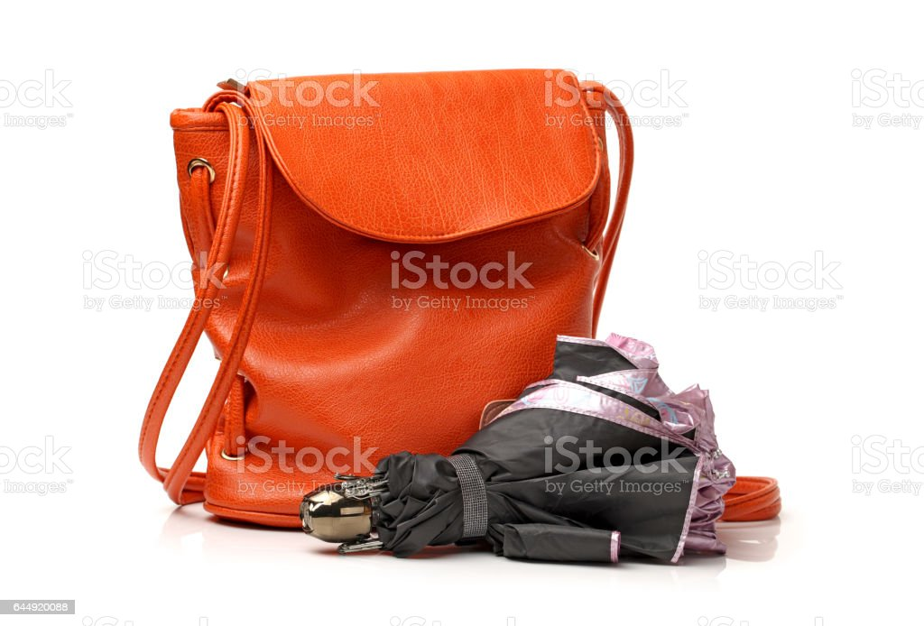 Orange Handbag leather and Folding umbrella on white background stock photo