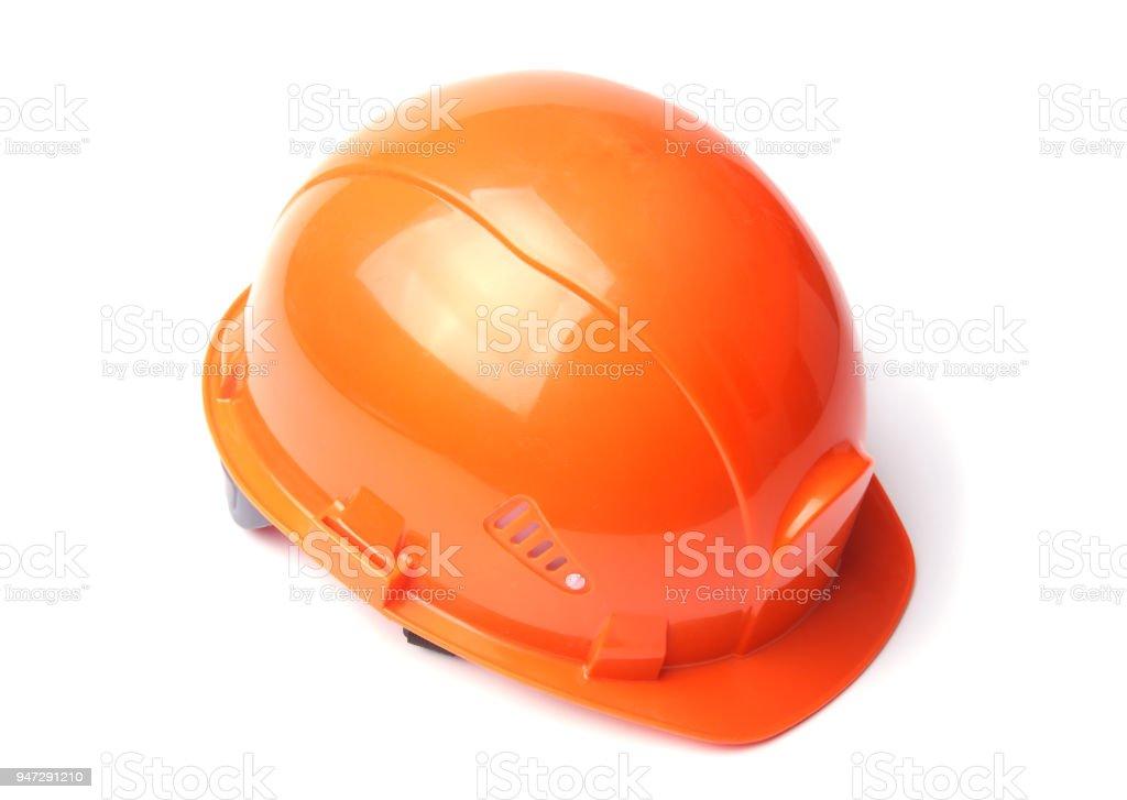 Orange hard hat isolated on white background. Safety helmet. stock photo