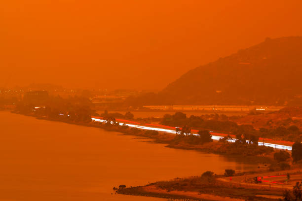 Orange haze over San Francisco Bay on September 9 2020 from record wildfires in Californa, ash and smoke during daytime stock photo