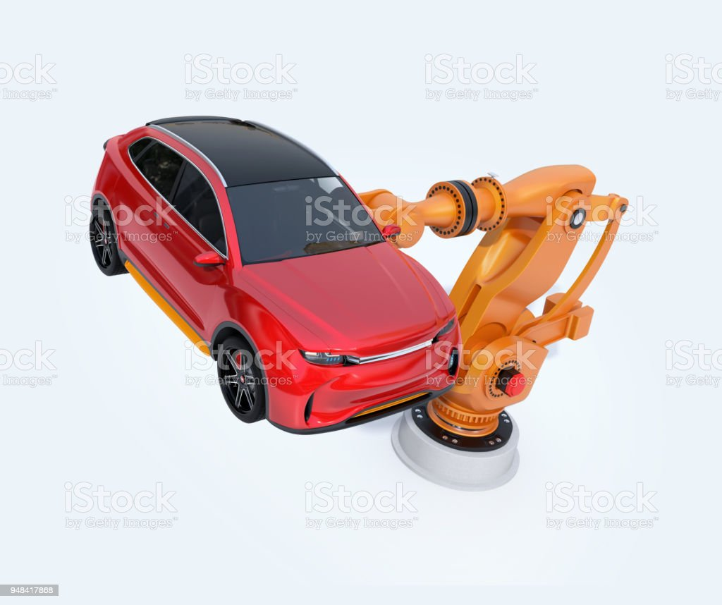 Orange heavyweight robotic arm carrying red SUV for assembly stock photo