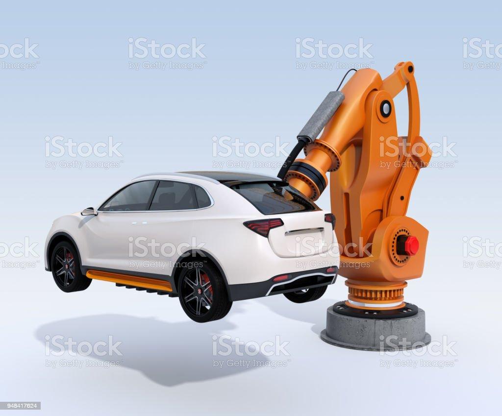 Orange heavyweight robotic arm delivering white SUV on light blue background stock photo