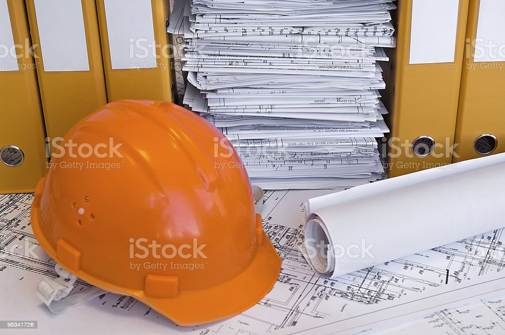 Orange helmet and project drawings royalty-free stock photo