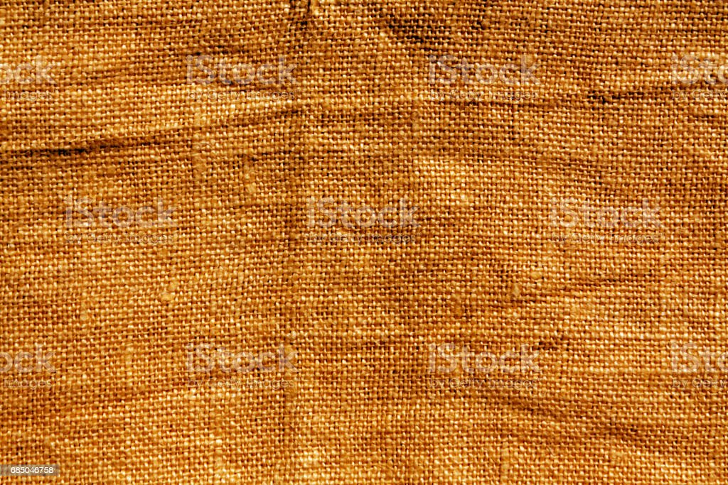 Orange hessian sack cloth texture stock photo
