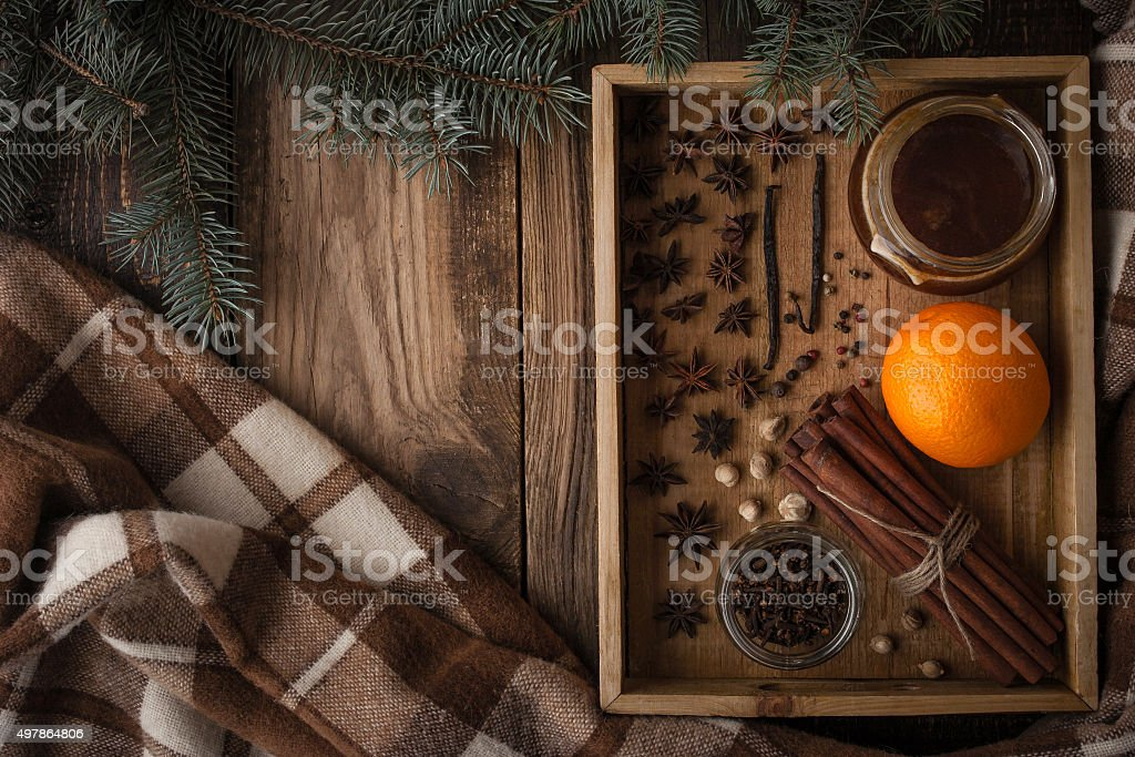 Orange , honey and spices on wooden tray  with plaid horizontal stock photo