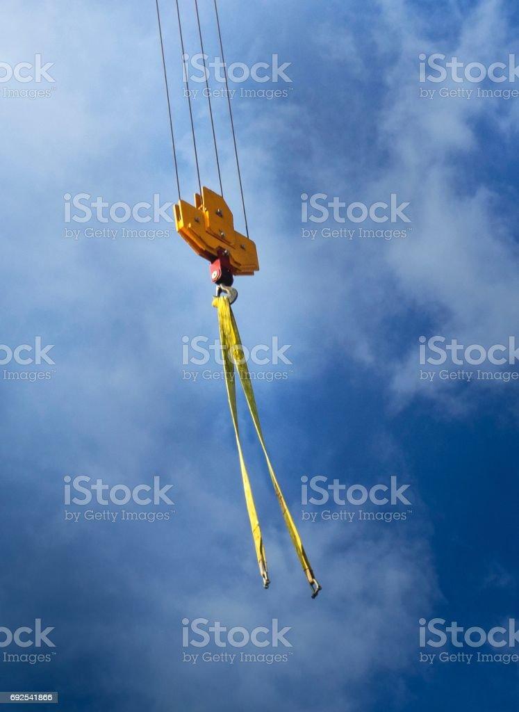 Orange Hooks on Blue Sky Background stock photo
