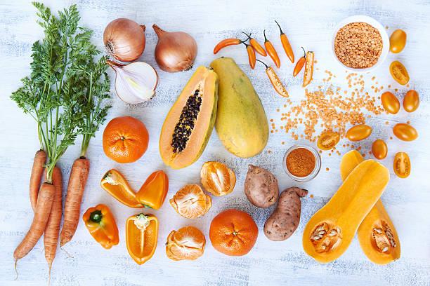 Orange hue toned collection fresh produce stock photo
