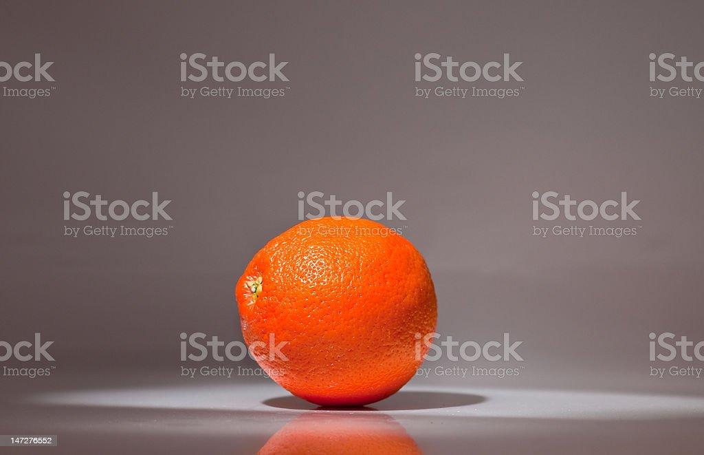 Orange in a lightbox royalty-free stock photo