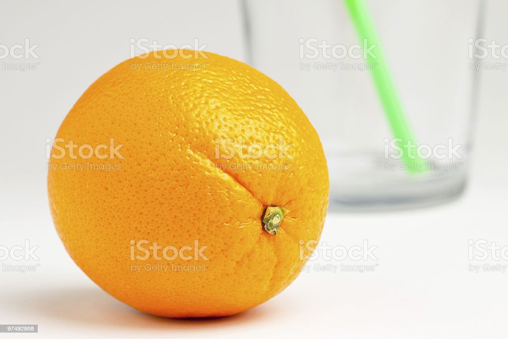 Orange in front of juice glass royalty-free stock photo