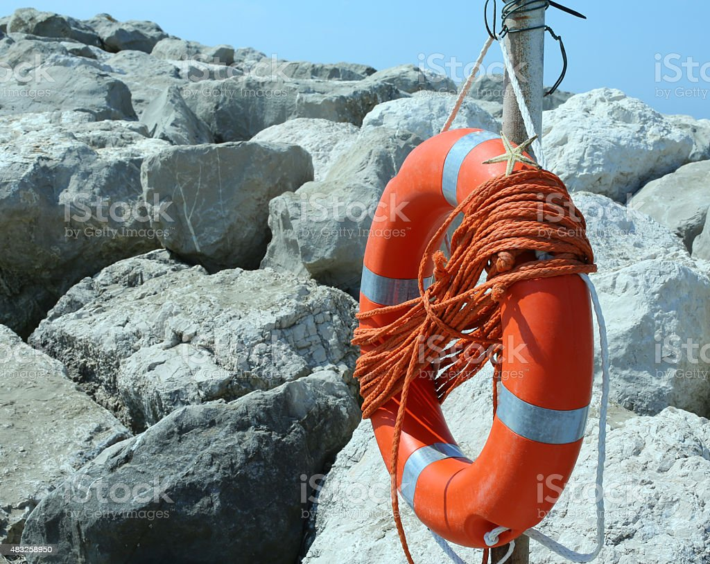 Orange jackets with rope to rescue swimmers in the sea stock photo
