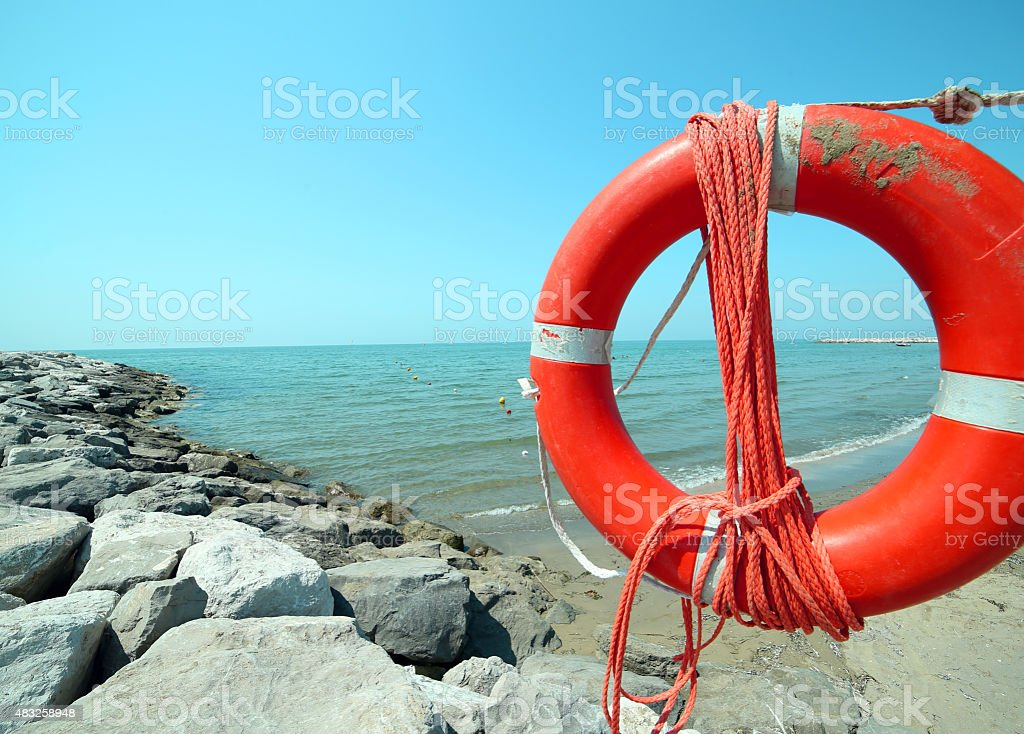 Orange jackets with rope to rescue swimmers stock photo