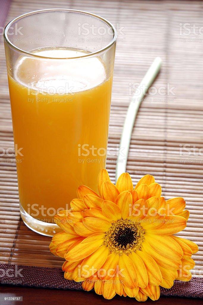 Orange Juice and Flower royalty-free stock photo