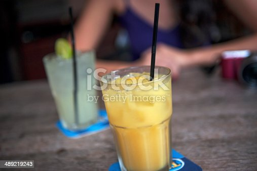 Orange juice and lemonade on table in a cafe