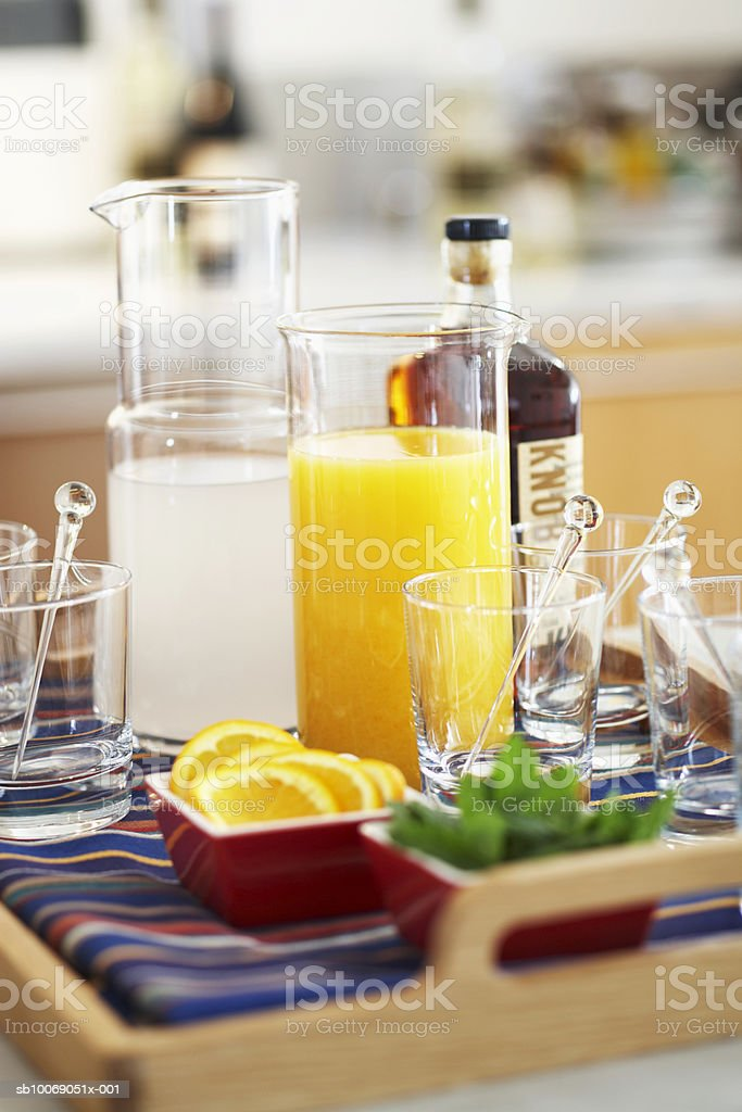 Orange juice and lemonade with glasses in tray foto de stock libre de derechos