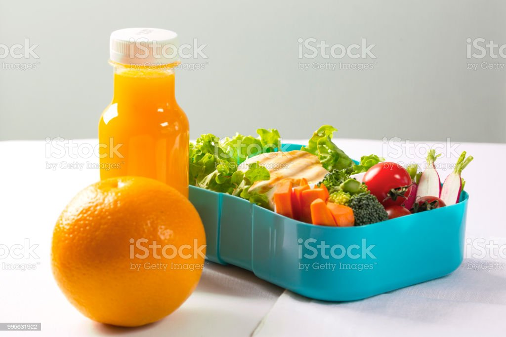 Orange Juice And Orange Plastic Box With Lunch Grilled Chicken Bread