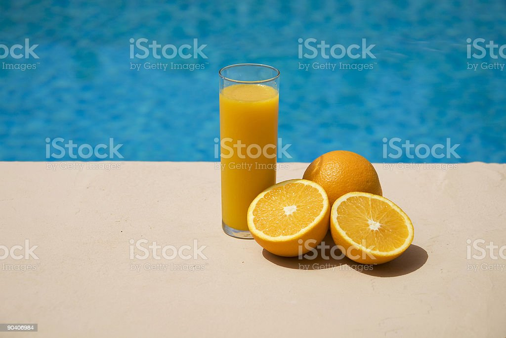 orange juice and oranges at the swimming pool royalty-free stock photo