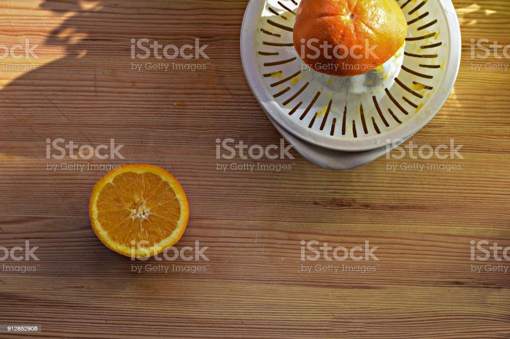 Orange juice and oranges on wooden background stock photo