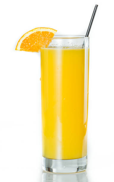 Orange Juice and vodka - srevewdriver closeup of a glass filled with fresh orange juice isolated on a white background screwdriver drink stock pictures, royalty-free photos & images