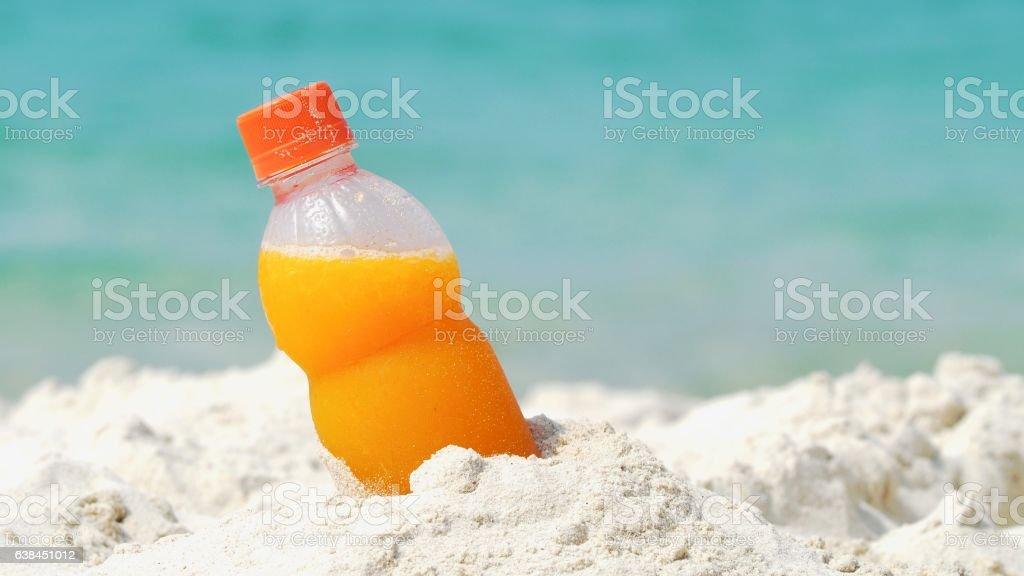 Orange juice at the beach stock photo