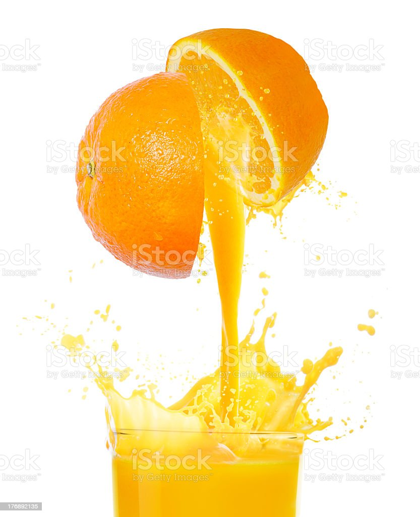 Orange juice being squeezed from an orange royalty-free stock photo
