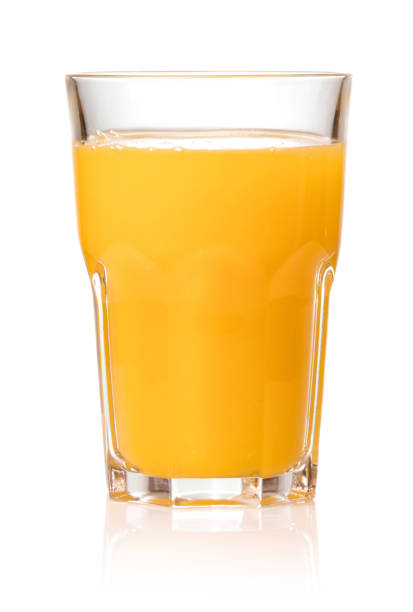orange juice in glass isolated on white background stock photo