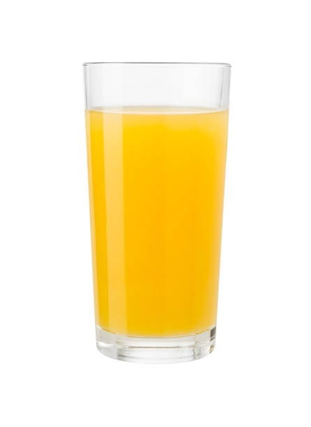 Orange juice in glass isolated on white with clipping path stock photo