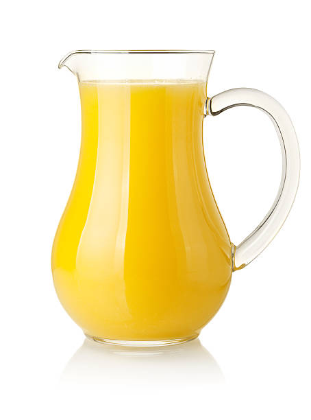Orange juice in pitcher stock photo