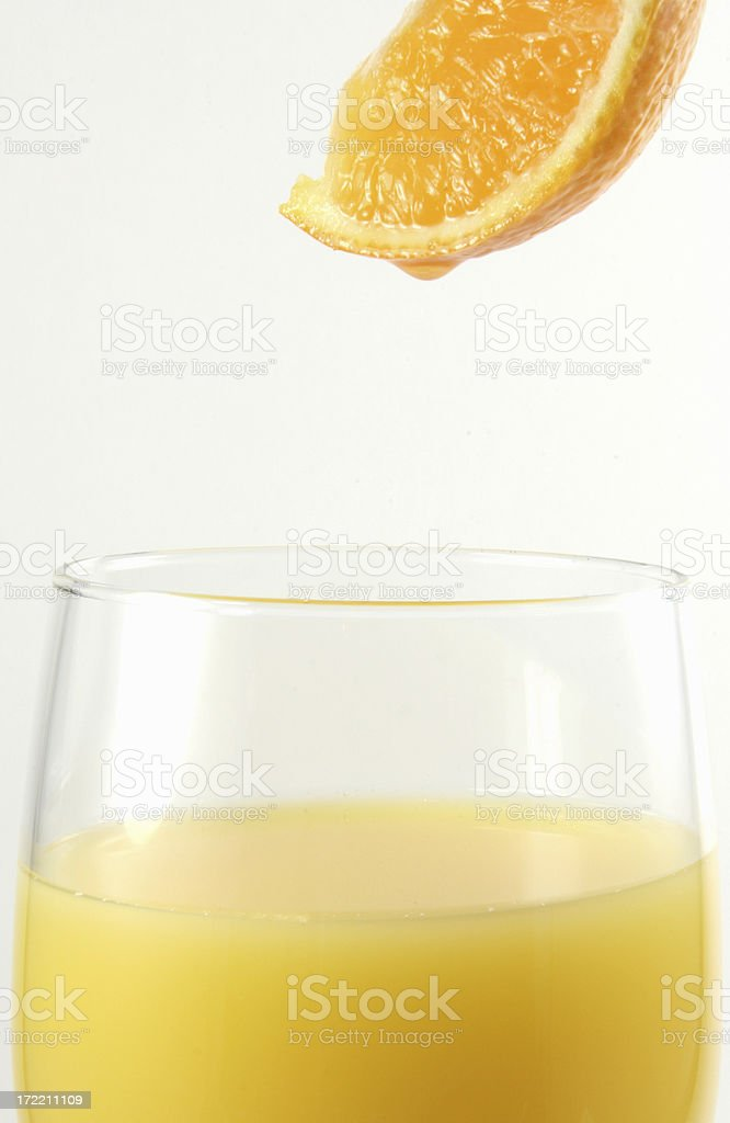 Orange juice into glass royalty-free stock photo