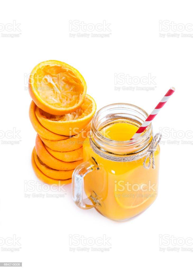 Orange juice isolated on white background with squeezed shells royalty-free stock photo