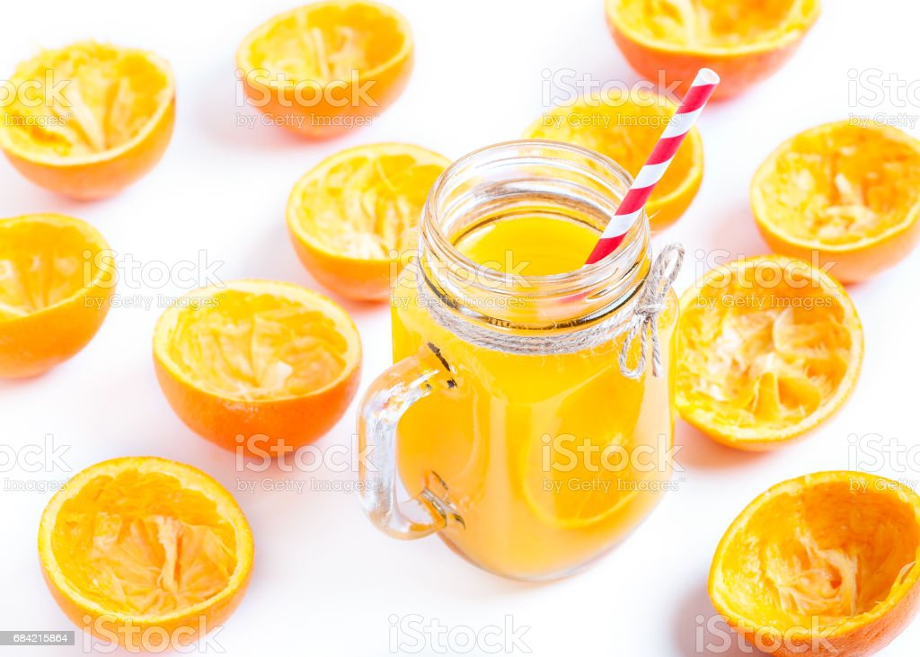 Orange juice isolated on white background with squeezed shells royalty-free stock photo