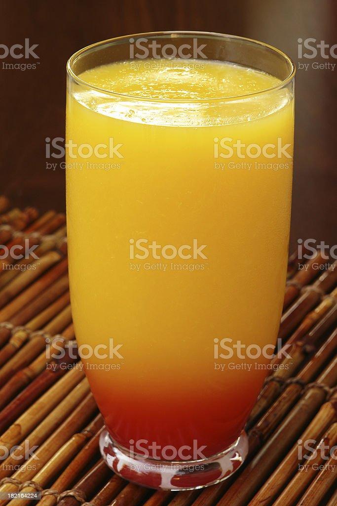 Orange juice on bamboo rods royalty-free stock photo