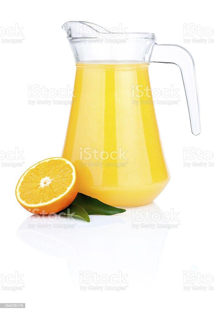 Orange juice pitcher, half oranges and leaves Isolated stock photo