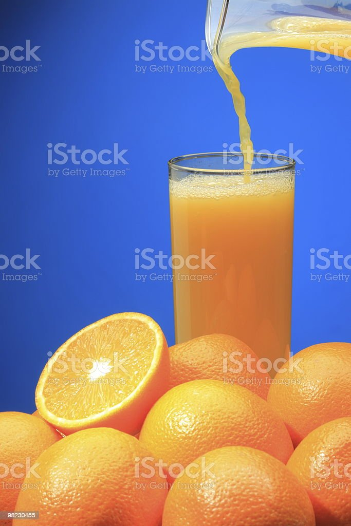 Orange juice pouring royalty-free stock photo