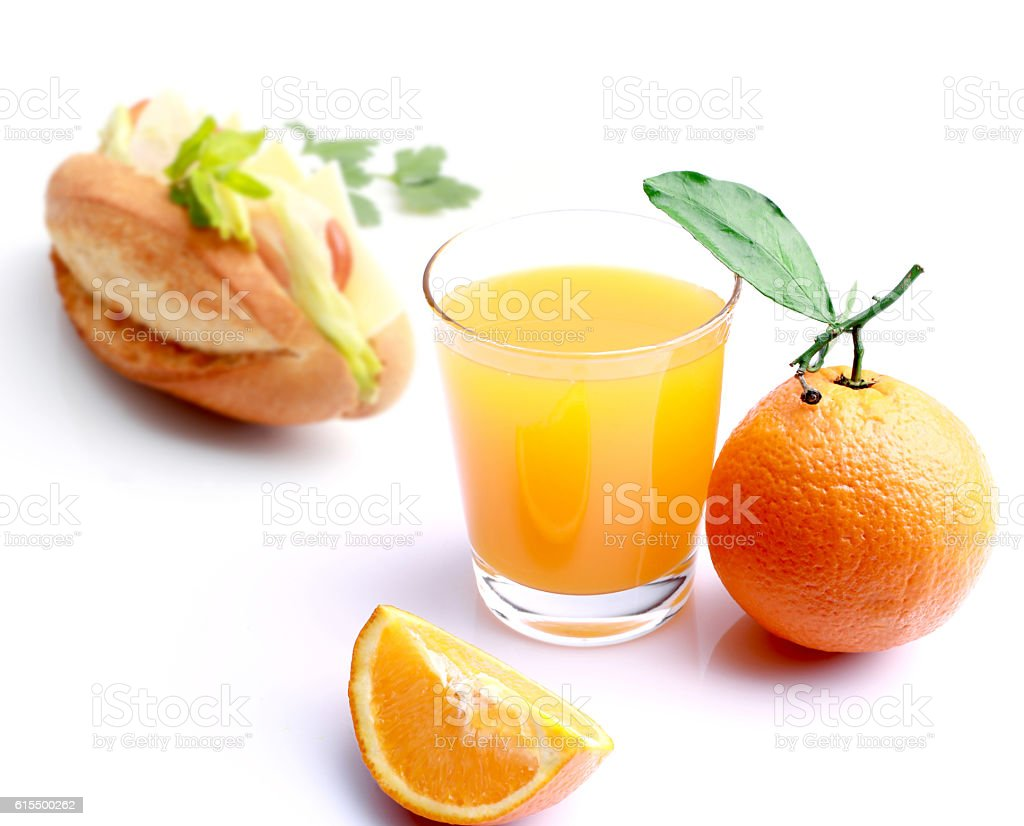 Orange juice with baguette stock photo