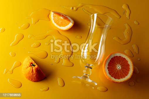 istock Orange juice with fruits on a yellow background. 1217859855
