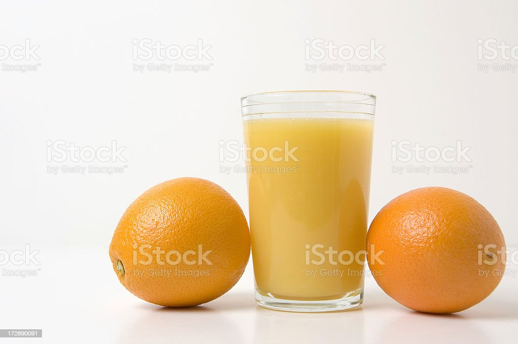 Orange juice with two fresh oranges stock photo