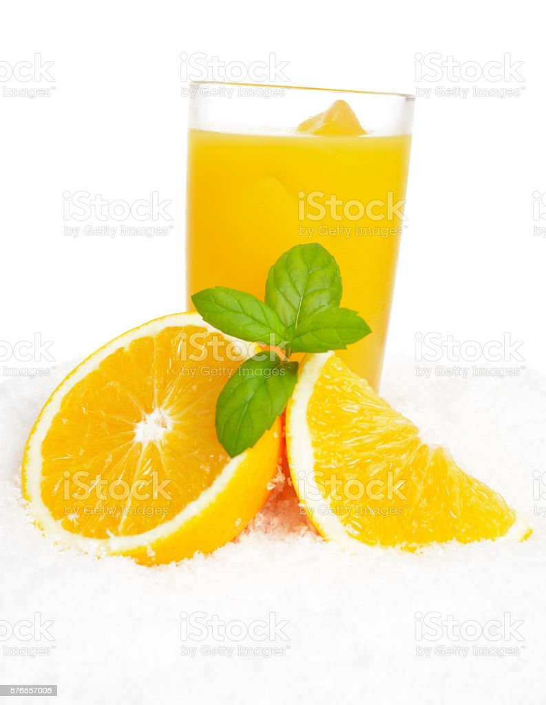 Orange juice,fruit,ice cubes, leaves on ice on white stock photo